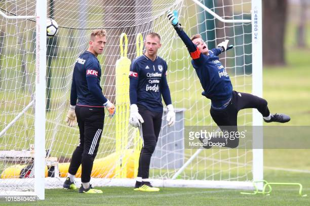Victory goalkeepers Lawrence Thomas and Matthew Acton watch Matthew Sutton dive for the ball during a Melbourne Victory training session at Gosch's...