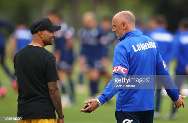 Victory Head Coach Kevin Muscat and former player Archie Thompson talk during a Melbourne Victory ALeague training session at Gosch's Paddock on...