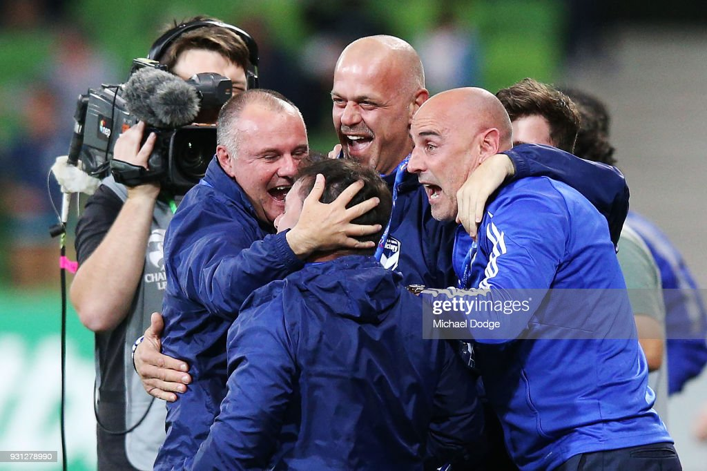 Victory head coach Kevin Muscat celebrates a goal by Kosta Barbarouses of the Victory with his assistants during the AFC Asian Champions League match between the Melbourne Victory and Kawasaki Frontale at AAMI Park on March 13, 2018 in Melbourne, Australia.