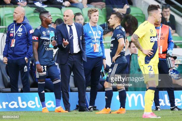 Victory head coach Kevin Muscat laughs at Leroy George of the Victory after he broke the goal net with a kick during the round 23 ALeague match...