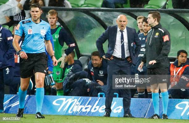 Victory Head Coach Kevin Muscat reacts after Diego Castro of the Glory was awarded a goal as the referee looks on during the round 16 ALeague match...