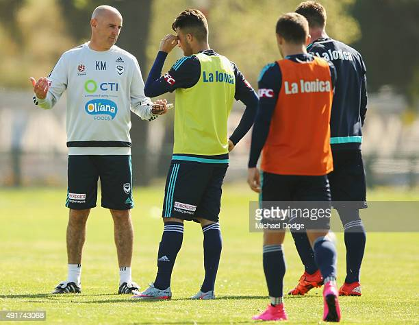 Victory Head Coach Kevin Muscat speaks to Kosta Barbarouses during a Melbourne Victory ALeague training session at AAMI Park on October 8 2015 in...