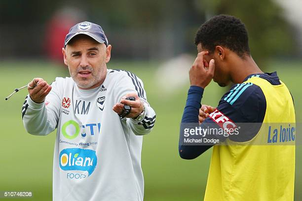 Victory head coach Kevin Muscat speaks to Rashid Mahazi of the Victory during a Melbourne Victory ALeague training session at Gosch's Paddock on...