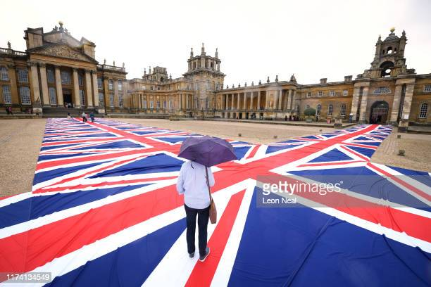 """Victory Is Not An Option"""", a giant walkway of British Union Flags created by artist Maurizio Cattelan, is seen at Blenheim Palace on September 12,..."""