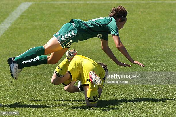 Victory keeper Brianna Davey collides with Nicole Sykes of United after stopping the ball during the round eight WLeague match between Melbourne...