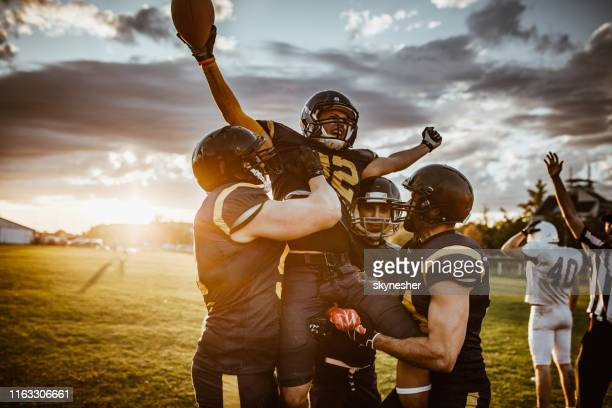 victory on american football match! - american football sport stock pictures, royalty-free photos & images
