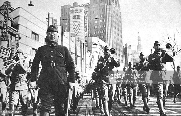 Victory parade as the Japanese enter a Chinese City during the 1937 invasion of China