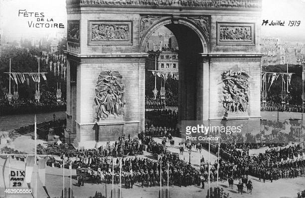 Victory parade, Paris, 14th July 1919. Parade at the Arc de Triomphe on Bastille Day to commemorate victory in the First World War. French postcard.