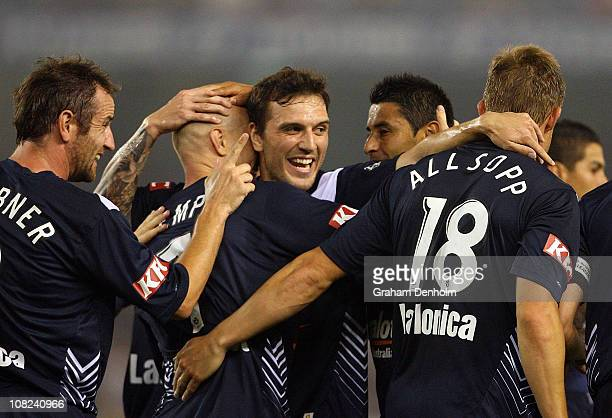 Victory players celebrate Allsop's goal during the round 24 ALeague match between the Melbourne Victory and the Melbourne Heart at Etihad Stadium on...