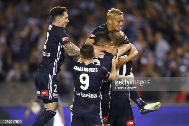 Victory players celebrate an Ola Toivonen goal during the round seven ALeague match between Melbourne Victory and Adelaide United at Marvel Stadium...