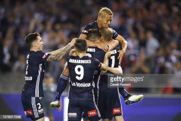 Victory players celebrate an Ola Toivonen goal during the round seven A-League match between Melbourne Victory and Adelaide United at Marvel Stadium...