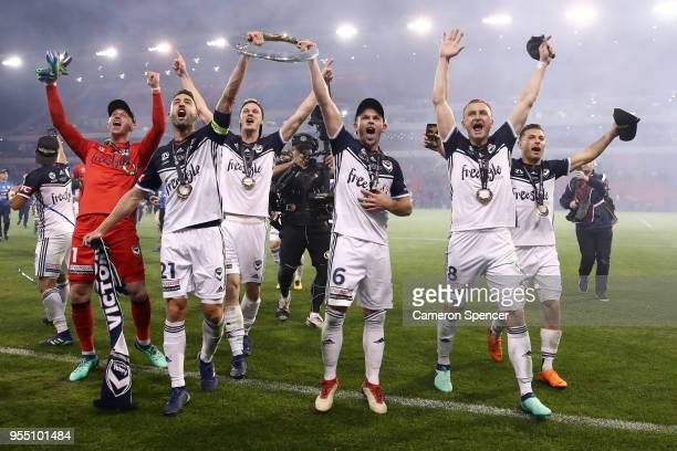 Victory players celebrate winning the 2018 ALeague Grand Final match between the Newcastle Jets and the Melbourne Victory at McDonald Jones Stadium...