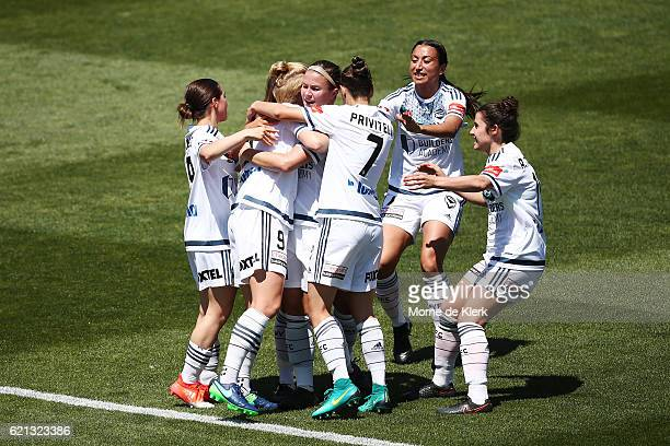 Victory players celebrate with Natasha Dowie of Melbourne Victory after she scored a goal during the round one WLeague match between Adelaide United...