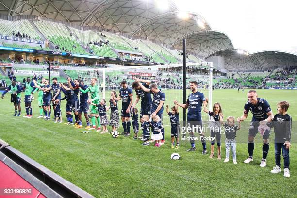 Victory players celebrates the win with their kids during the round 23 ALeague match between the Melbourne Victory and the Central Coast Mariners at...
