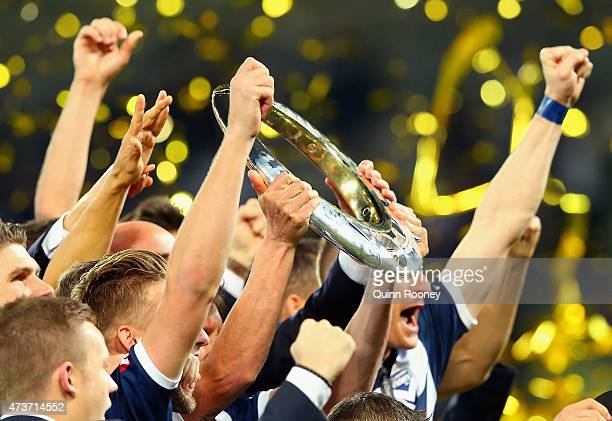 Victory players hold the trophy aloft after winning the 2015 ALeague Grand Final match between the Melbourne Victory and Sydney FC at AAMI Park on...