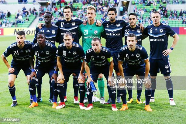 Victory players pose during the AFC Asian Champions League match between the Melbourne Victory and Kawasaki Frontale at AAMI Park on March 13 2018 in...