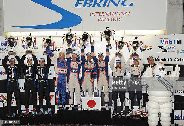 Victory podium L-R 2nd place drivers of the Highcroft Racing HPD of David Brabham, Simon Pagenaud, Marino Franchitti, 1st place winners Hughues de...