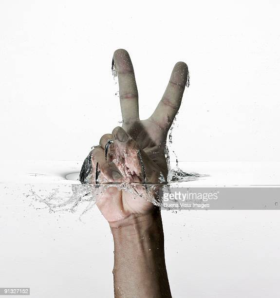 Victory sign in water