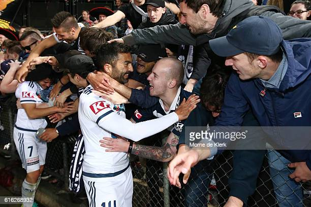 Victory supporters celebrate after the round three ALeague match between Adelaide United and Melbourne Victory at Coopers Stadium on October 22 2016...