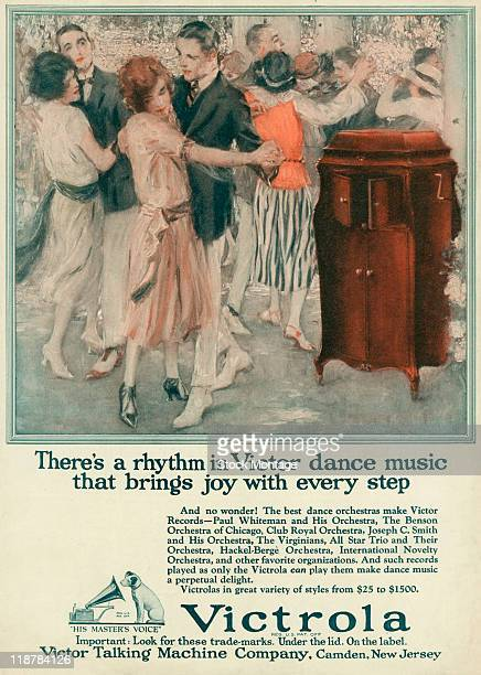 A Victrola phonograph is shown in a magazine advertisement 1922 A welldressed group of people is dancing to music from the Victrola The headline...
