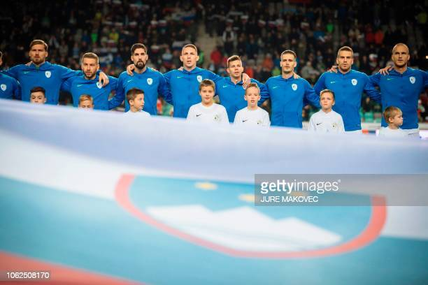 Vid Belec Nejc Skubic Miha Mevlja Rajko Rotman Miha Zajc Andraz Struna Domen Crnigoj and Aljaz Struna look on as anthems play prior to the UEFA...