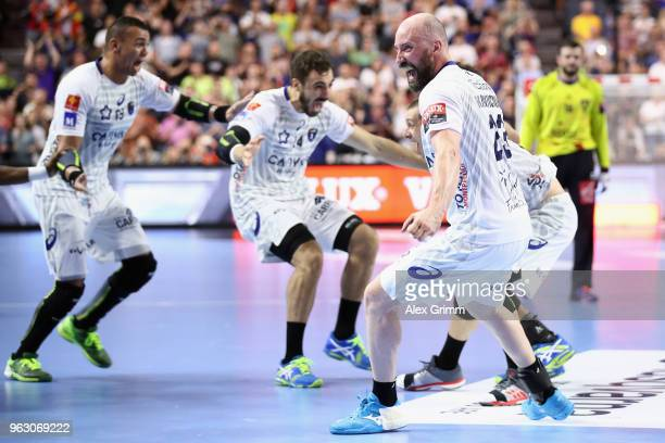 Vid Kavticnik and team mates of Montpellier celebrate winning the EHF Champions League Final 4 Final match between Nantes HBC and Montpellier HB at...