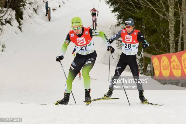 Vid Vrhovnik of Slovenia and Aguri Shimizu of Japan during the Nordic Combined World Cup at WM Stadion Ramsau on December 23, 2018 in Ramsau, Austria.