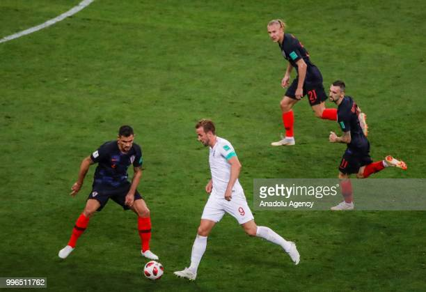 Vida and Marcelo Brozovic of Croatia in action against Harry Kane of England during the 2018 FIFA World Cup Russia Semi Final match between England...