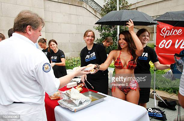 Vida Guerra promotes PETA's 2010 National Veggie Dog Day at the Rayburn House Office Building Courtyard on July 14, 2010 in Washington, DC.