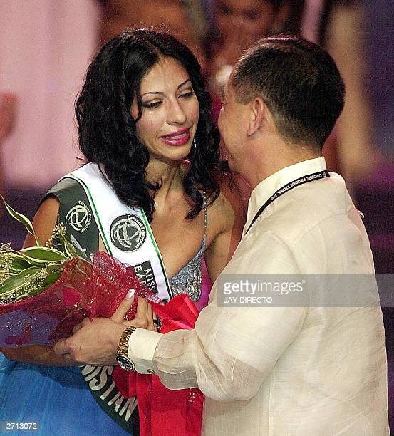 Vida Samadzai of Afghanistan cries as she receives the 'Beauty For A Cause' award during the 2003 Miss Earth contest in Manila 09 November 2003 Dania...