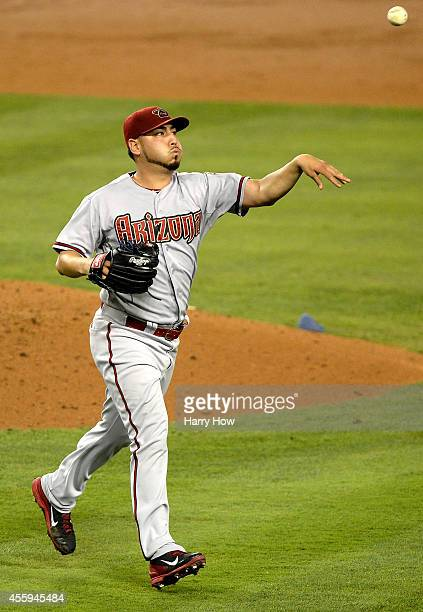 Vidal Nuno of the Arizona Diamondbacks makes a fielding play to throw out Adrian Gonzalez of the Los Angeles Dodgers to end the second inning at...