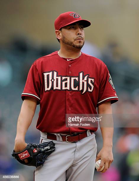 Vidal Nuno of the Arizona Diamondbacks reacts during the first inning of the game against the Minnesota Twins on September 24 2014 at Target Field in...