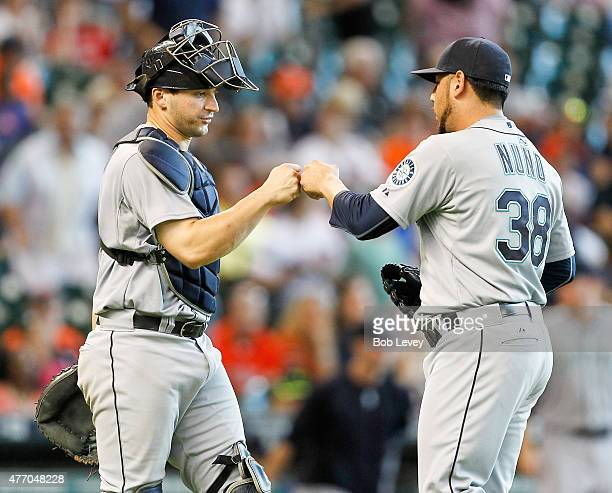 Vidal Nuno of the Seattle Mariners bumps fist with Mike Zunino after the final out against the Houston Astros at Minute Maid Park on June 13 2015 in...