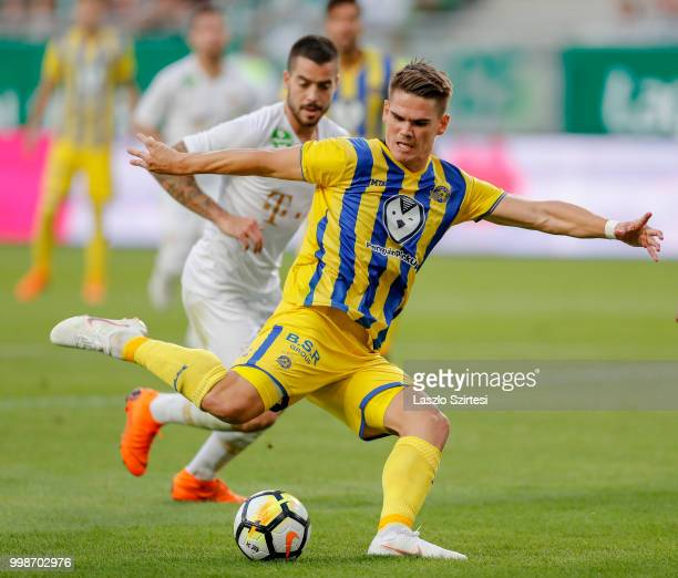 Vidar Kjartansson of Maccabi Tel Aviv FC shoots on goal in front of Endre Botka of Ferencvarosi TC during the UEFA Europa League First Qualifying...