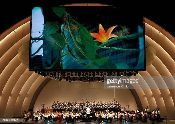 Video artist Herman Kolgen's video of Gustav Klimt's imagery projected on the screen as conductor Leonard Slatkin conducting the LA Phil's summer...