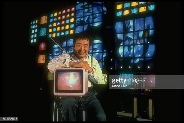 Video artist Nam June Paik w his video sculpture Fin de Siecle II