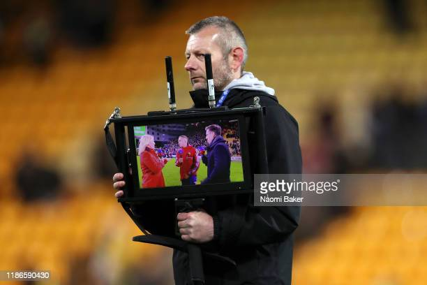 Video Assistant holds up a screen towards the presenters showing the live output during the Premier League match between Norwich City and Watford FC...
