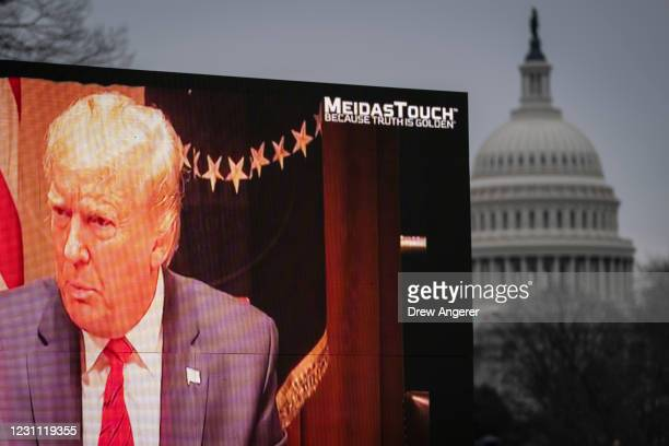 Video billboard calling for the conviction of former U.S. President Donald Trump plays near the U.S. Capitol on the fourth day of former President...