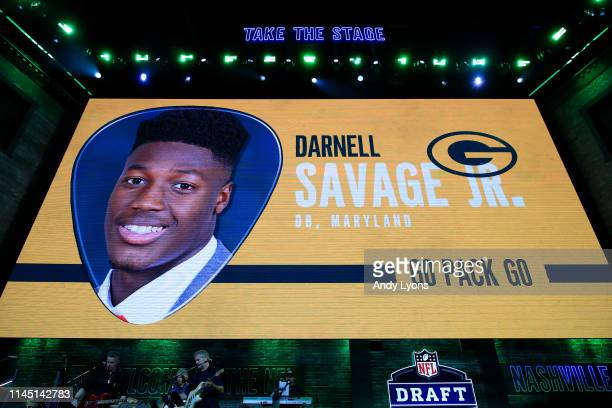 A video board displays an image of Darnell Savage Jr after he was chosen overall by the Green Bay Packers during the first round of the 2019 NFL...