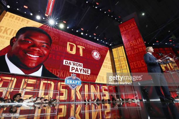 A video board displays an image of Da'Ron Payne of Alabama after he was picked overall by the Washington Redskins during the first round of the 2018...