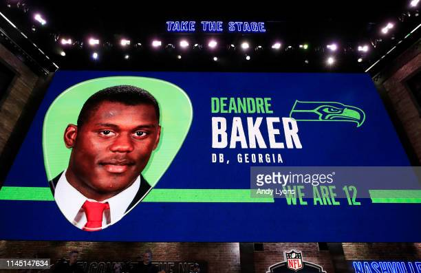 A video board displays an image of Deandre Baker of Georgia after he was chosen overall by the New York Giants during the first round of the 2019 NFL...