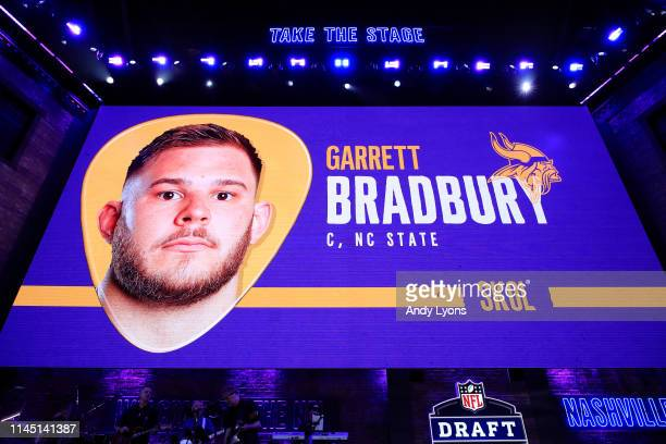 A video board displays an image of Garrett Bradbury of NC State after he was chosen overall by the Minnesota Vikings during the first round of the...