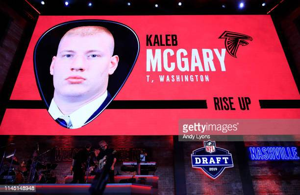 A video board displays an image of Kaleb Mcgary of Washington after he was chosen overall by the Atlanta Falcons during the first round of the 2019...