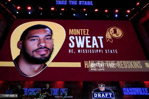 A video board displays an image of Montez Sweat of Mississippi State after he was chosen overall by the Washington Redskins during the first round of...