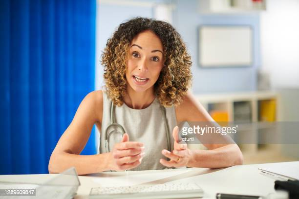 video call doctor - discussion stock pictures, royalty-free photos & images