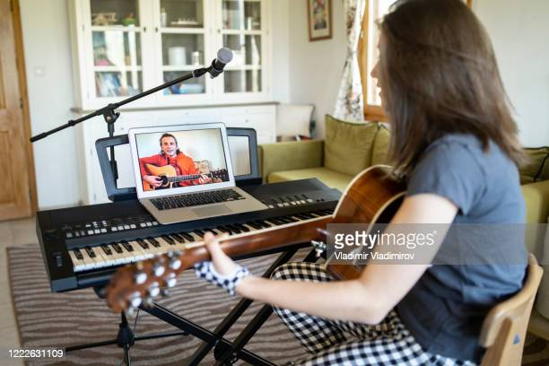video call during music lesson - singer stock pictures, royalty-free photos & images