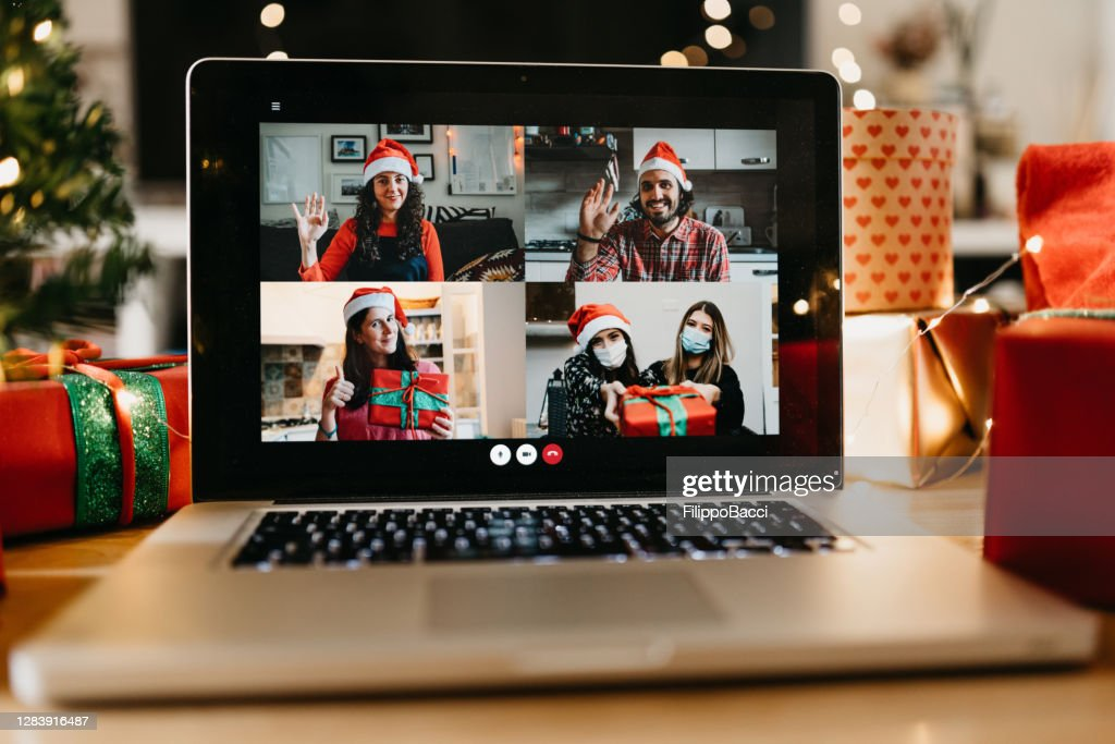 Video call on a laptop screen during Christmas : Stock Photo