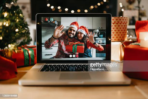 video call on a laptop screen during christmas - illness prevention stock pictures, royalty-free photos & images
