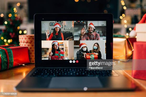video call on a laptop screen during christmas - christmas stock pictures, royalty-free photos & images