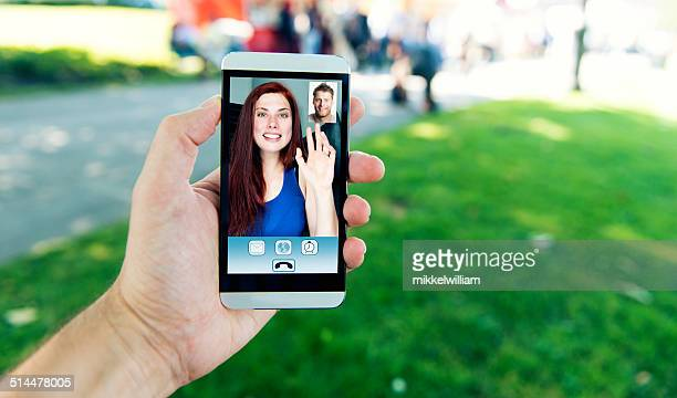 Video call on mobile phone between man and woman